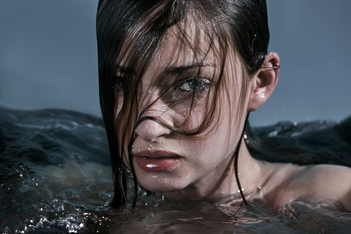 A portrait of a female model with her head above water. The second place winner of the Lens Culture portrait award 2017