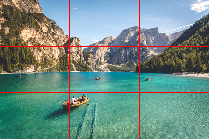 An image of a beautiful tropical coastal scene with the rule of thirds composition grid overlayed, the points of interest falling on the horizontal lines